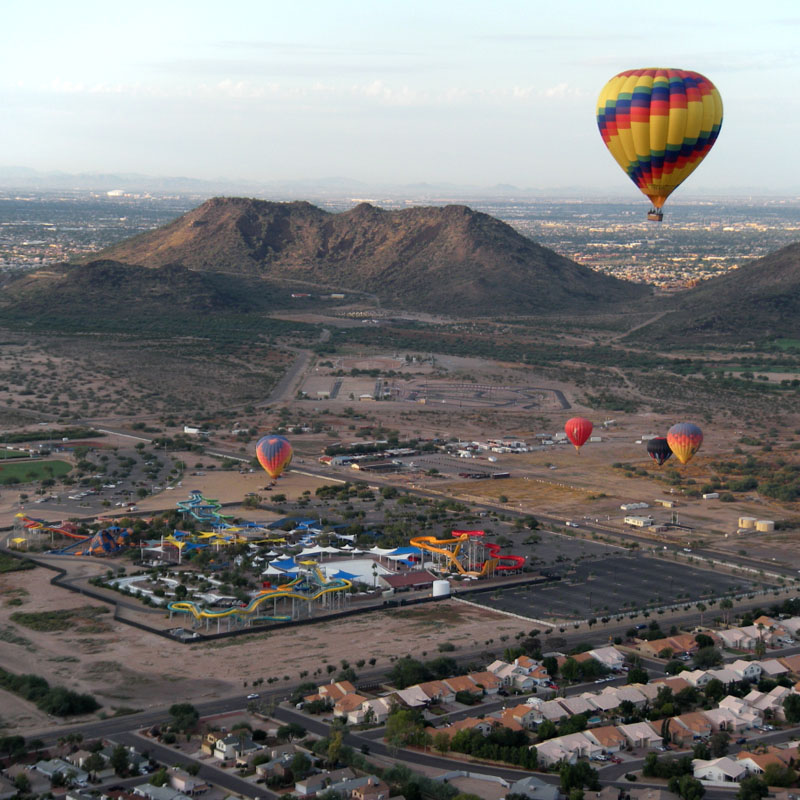 Several Hot Air Balloons floating over Phoenix town
