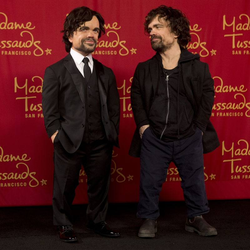 Peter Dinklage standing next to his wax statue
