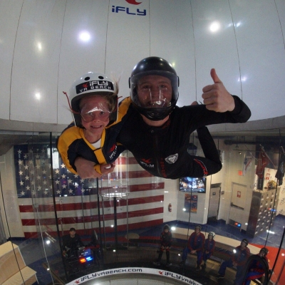 Two people hovering in the air with thumbs up